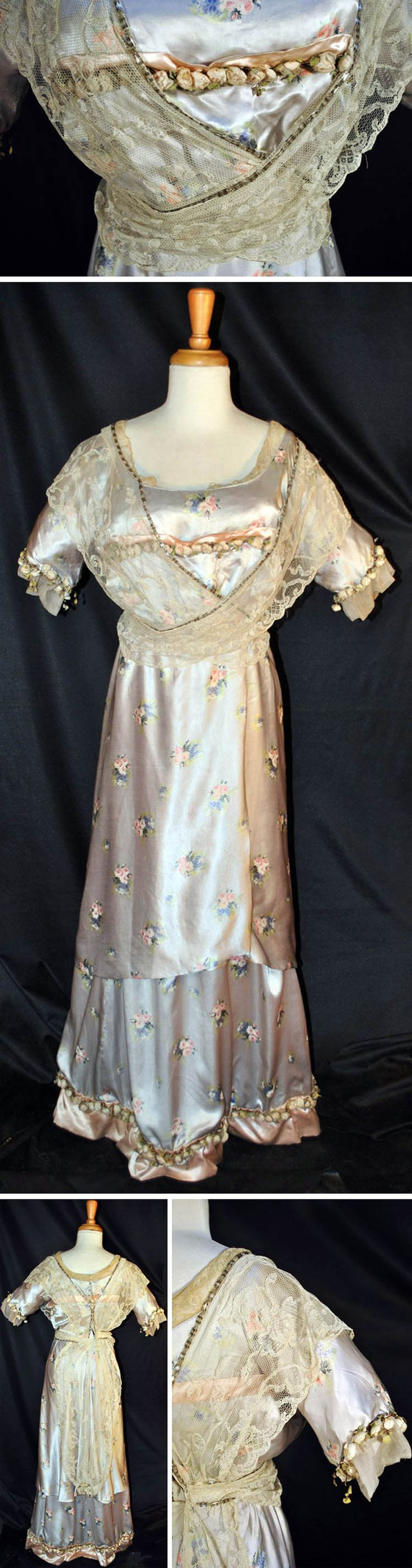 Evening dress, Thurn, New York, ca. 1915. Printed floral satin with low, rounded neckline and short sleeves. White lace with white glass beads at bodice and down back. Sleeves trimmed with tulle and fabric florets (also below bustline & in back). Back hook & eye closure from neck through hips. Old Threads Antique Textiles/ebay