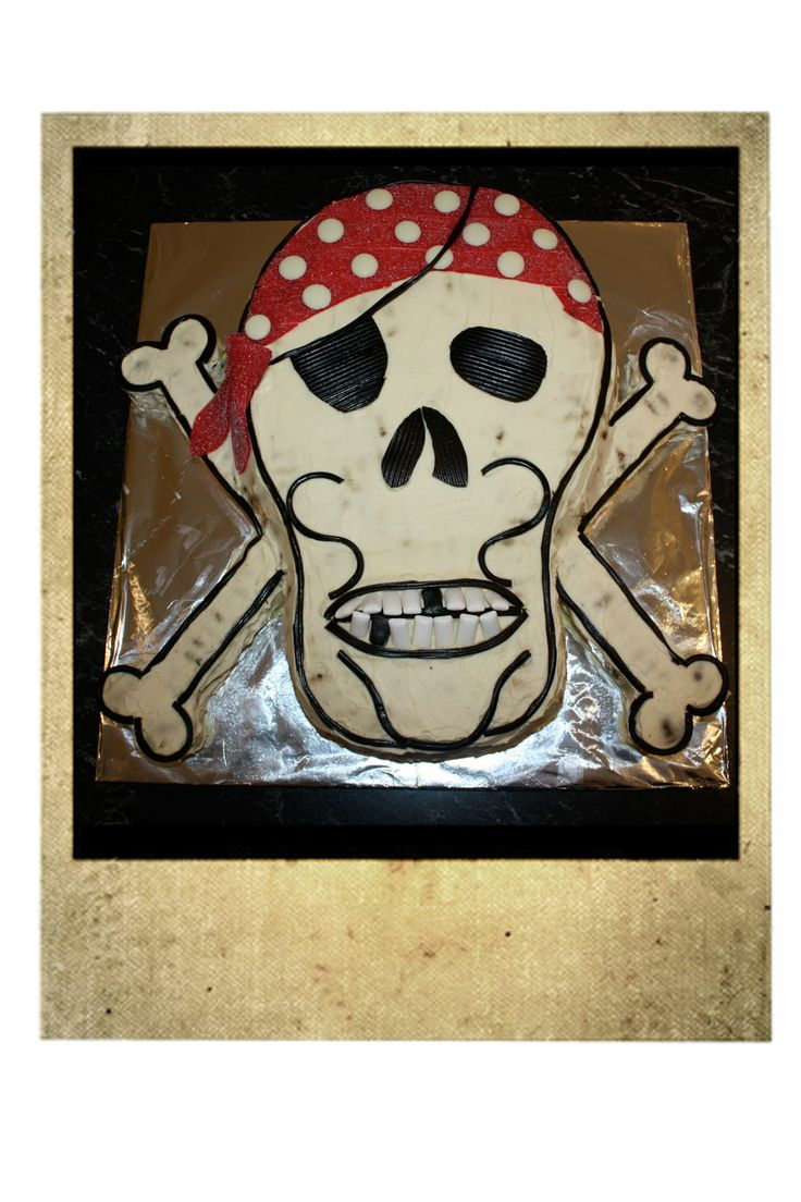 G's 5th Birthday Pirate Party Skull n Cross Bones Cake.  Chocolate Ripple with liquorice, fruit strap, chewies, and white chocolate buds.