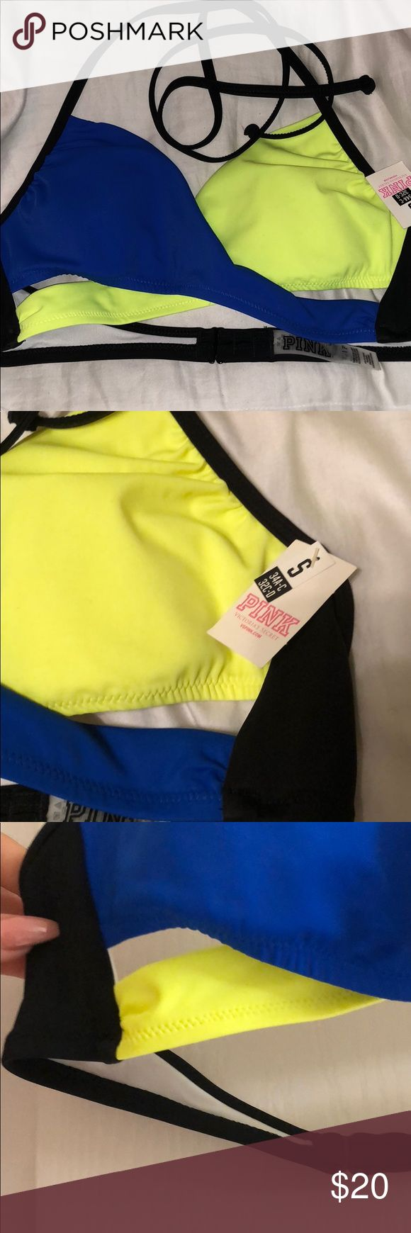 NWT VS Pink brand Blue and Hot Yellow Bikini Top Cute royal blue and hot yellow bikini top. Black back and straps. Ties around the neck with a fasten in the back. NWT never worn. Small cut outs in the front.  Can be worn with blue,hot yellow or even black bikini bottoms. Size S (34A-C or 32 C-D) Removable padding Victoria's Secret Swim Bikinis