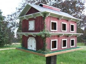 Red Barn Purple Martin House... Either the holes are too big or the bird house too small for purple martins. Really nice idea, though.