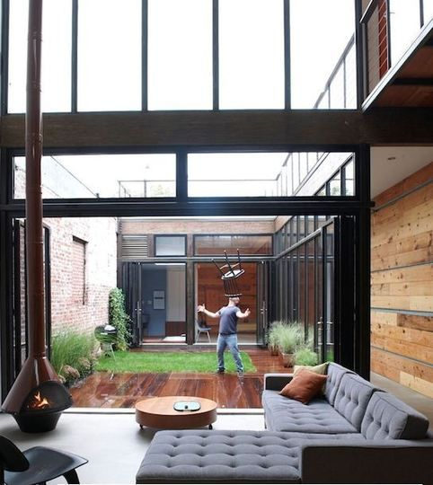 gorgeous indoor/outdoor space and i LOVE the couch and woodburning fireplace. (ps - that's steve from blue's clues in the background, this is his home) LUCKY!!!