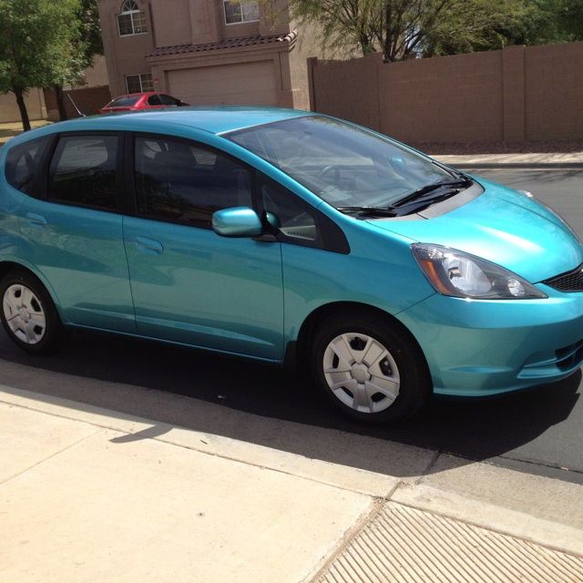 My 2012 Honda Fit in Blue Raspberry Metallic - the reason for my teal obsession.