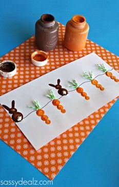 Fingerprint bunny and carrot picture. This is an adorable idea for the kids to make on Easter Sunday while waiting for lunch!