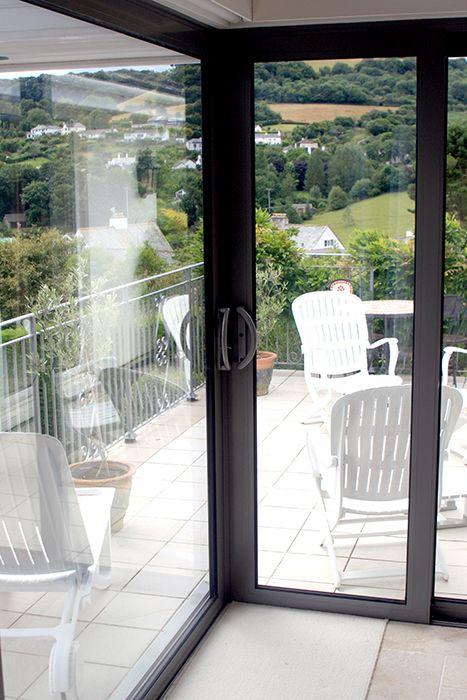 Sunflex UK's SVG Plus sliding door installed by Devonshire Windows