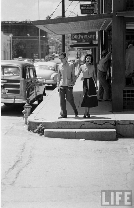 Silver City, New Mexico. 1950. I can say after visiting there in 2015 that this street and those high ankle wrenching curbs look pretty much the same.