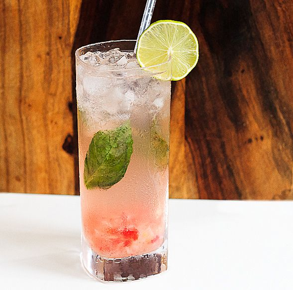 Tropical Hurricane Irene Cocktail with Coconut Water, infused with Basil and Strawberries // wishfulchef.com