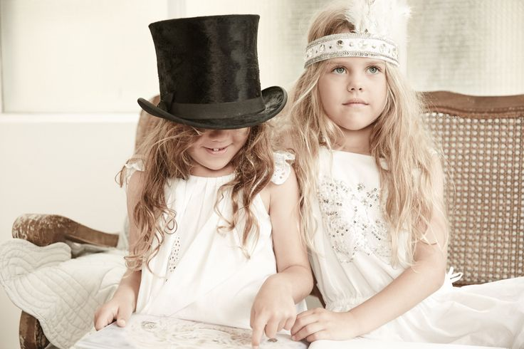 best friends share books feathers and stories .... photography Sam Elsom