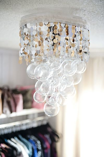 This would be so cool in my closet with beaded fringe instead of sequins.--DIY Ornament & Sequins Chandelier
