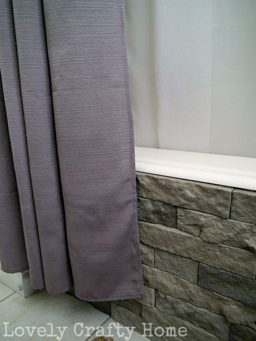 Makeover a plain tub with stone cladding