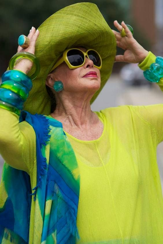 awesome yellow and blue outfit with huge sunglasses and hat for senior women