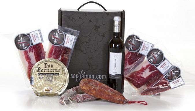 9-Piece Ibéricos Chorizo, Ham, Cheese and Wine Hamper Throw a Spanish-themed party with this 9-Piece Ibéricos Hamper      A platter of the best products of Spanish cuisine; chorizo, salchichón, Iberian ham      And Manchego cheese,a traditional, creamy Spanish cheese,and fine wine from Cigales      All meats are expertly cut and vaccum packed      The signature bellota jamón ibérico is...