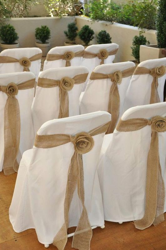white or ivory chair covers with burlap rose sashes to cover ugly folding chairs