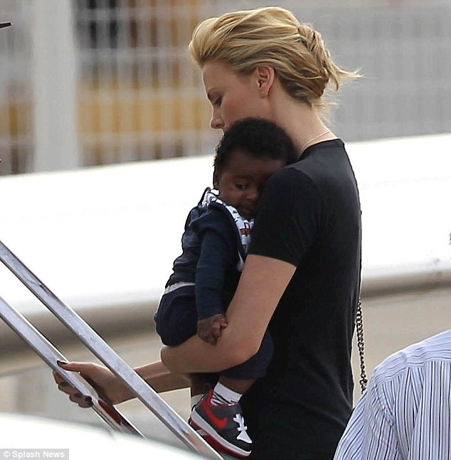 Charlize Theron is photographed holding her son, Jackson Theron.