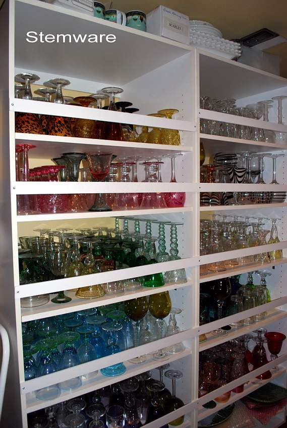 Dish room of  BONNIE a very creative tablescaper.Beautiful glass storage and  organization.