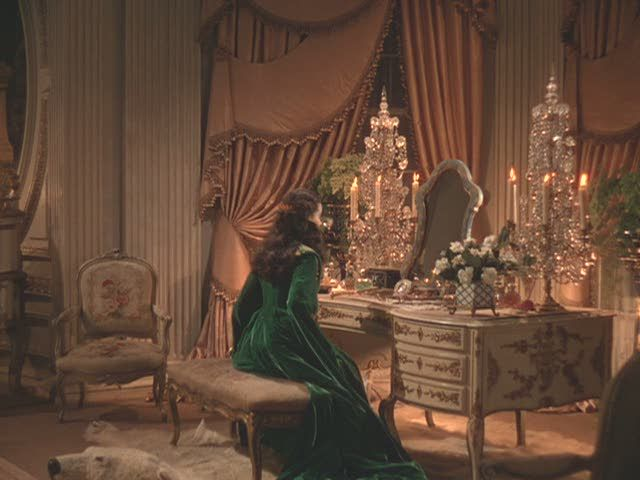 Check out vanity area of Scarlett's room–the crystal light fixtures, the swooping draperies, and is that a polar bear rug?
