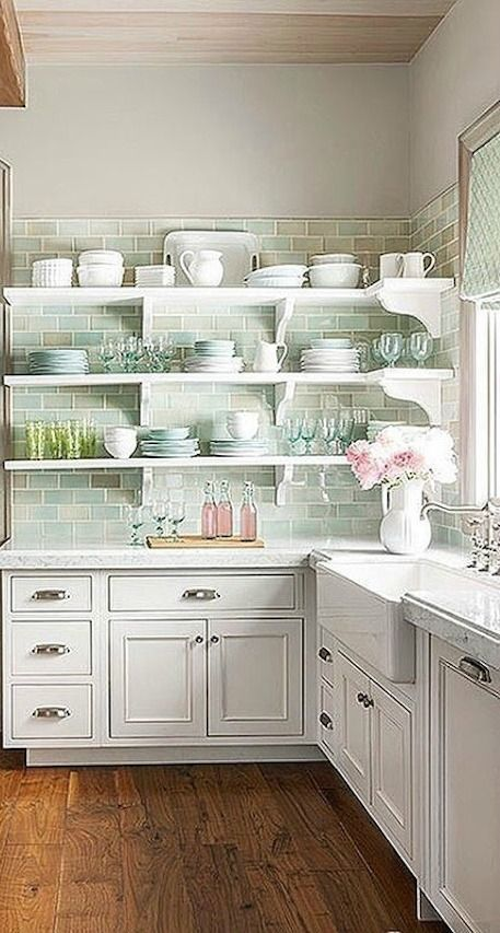 Soft pastels in aqua and pink in a beautiful white French Country kitchen by Decor de Provence. #FrenchCountry #shelves #romanticcountry