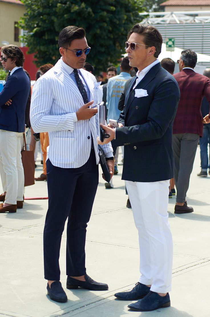 Blue Sunglasses — Light Blue Dress Shirt — White and Navy Vertical Striped  Blazer — Navy Dress Pants — Navy Suede Loafers — Navy Print Tie