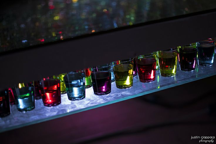 Different coloured water in glasses that created a colourful effect at Malta Design Week, Fort St.Elmo Valletta