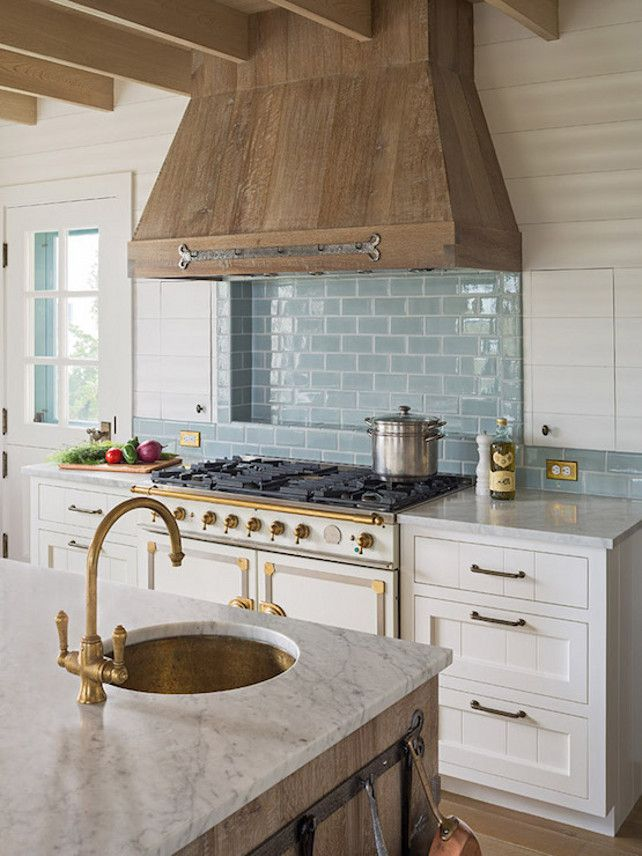 Rustic French Kitchen. French kitchen with wood plank ceiling over a barn board kitchen island topped with a white marble countertop framing a hammered copper prep sink and brushed brass faucet. #FrenchKitchen Dearborn Builders