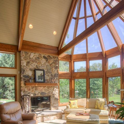 Today's idea. For a true wall of windows, custom glass panels were installed above the Andersen windows. Addition Design by Cripe Design, general contracting by Martin Bros. Contracting, Inc.; photo by Dave Hubler Photography. #wallofwindows #sunroom #sunroomaddition #remodelingproject #ideaoftheday #martinbroscontractinginc #martinbroscontracting #michiana #remodelingsolutions #remodelingideas #glasspanels #andersenwindows #vaultedceiling #fieldstonefireplace #pennsylvaniafieldstone…