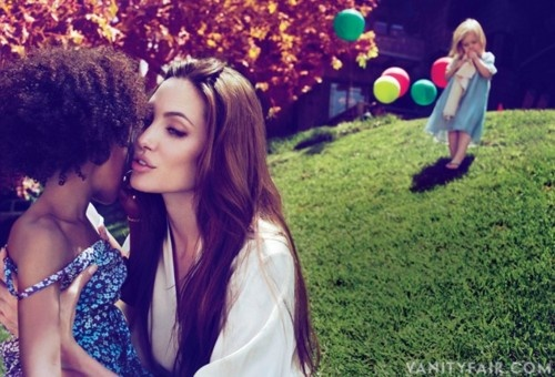 Angelina Jolie and her daughters.  This photo intrigues me...