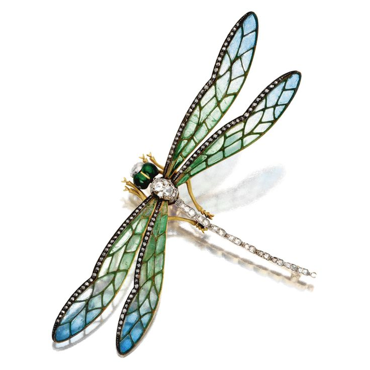 ART NOUVEAU PLIQUE-À-JOUR ENAMEL AND DIAMOND DRAGONFLY BROOCH, CIRCA 1900. The wings mounted en tremblant, decorated with green and blue plique-à-jour enamel and edged in rose-cut diamonds, the body set with small old-mine and single-cut diamonds, the head of green enamel, mounted in gold and silver.
