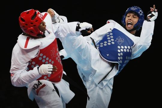 Lutalo Muhammad of G.B. against Farkhod Negmatov of Tajikistan in the Men's -80kg Taekwondo