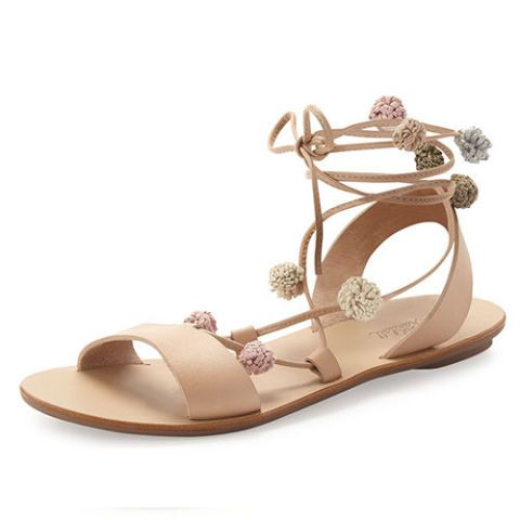 $250 BUY NOW Beige sandals are a must for any shoe collection, but they're not always so exciting. Scattered pompoms and lace-up ties give these neutral beauties a little more bite. (Plus they're simple enough to wear season after season.)