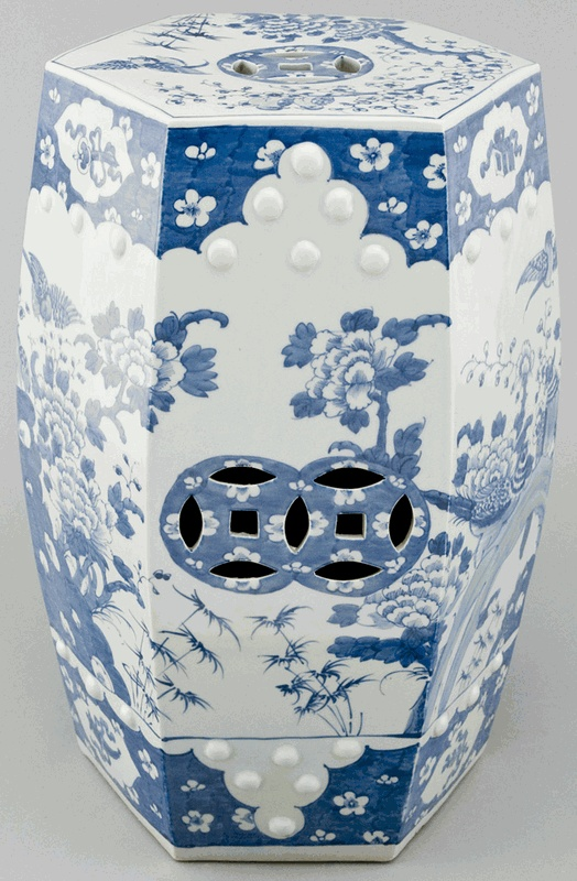 Six-sided, blue and white porcelain Chinese garden stool with delicate floral designs. Open carving on top and sides of stool and porcelain studs adorn the top area designs. Porcelain garden stools can be used indoors or outdoors and work as a stool or a table.