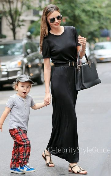 Seen on Celebrity Style Guide: Miranda Kerr wore black short sleeve maxi dress by The Row with her son Flynn in New York on October 6 2013