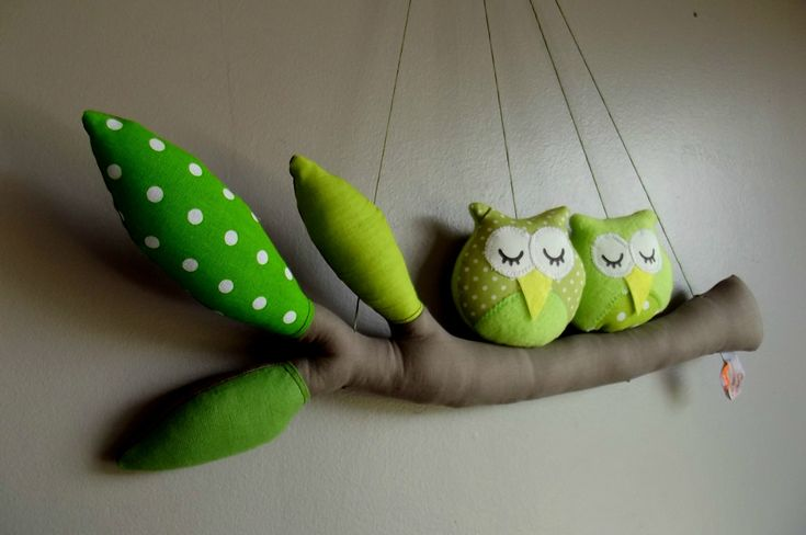 Owls on a tree branch sleeping ...I love these little plushie toy owls and their softie branch to sit on great wall hanging ,mobile toy for kids room or gift for owl lovers