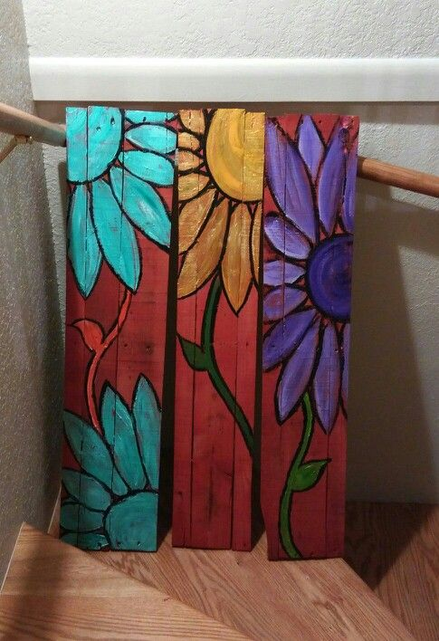 Pallet art fun - we made these by biscuit joining the pieces together, spray painting a thin red coating, then using acrylic paint for the flowers