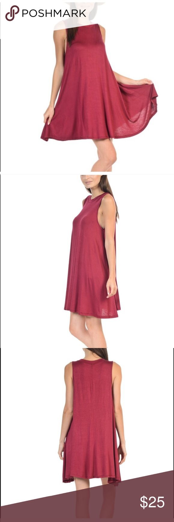 Burgundy sleeveless tshirt dress Burgundy colored sleeveless tshirt dress. Very soft and stretchy material. Perfect staple piece to dress up or down, and to transition all year round. Price is firm. Dresses