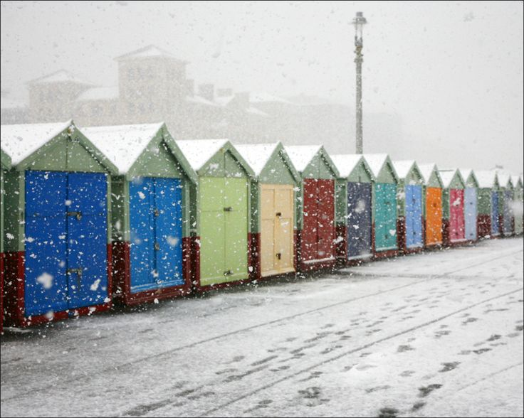 Beach huts in the snow.
