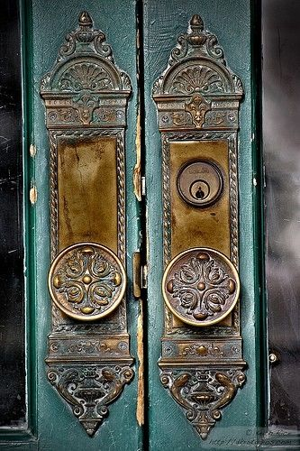 Beautiful antique doorknobs and backplates. The turquoise door really makes them stand out, too.