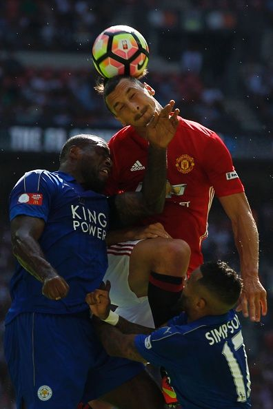 Manchester United's Swedish striker Zlatan Ibrahimovic beats Leicester City's English defender Wes Morgan to a header during the FA…