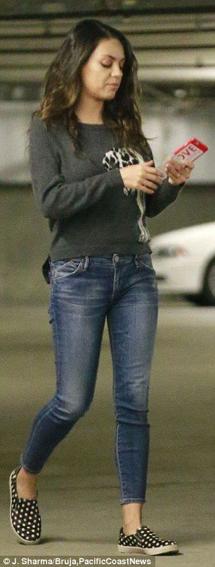 Back in shape: Mila Kunis was back in her skinny jeans on Thursday in Santa Monica, California, having regained her toned tummy after giving birth October 1 to daughter Wyatt Isabelle