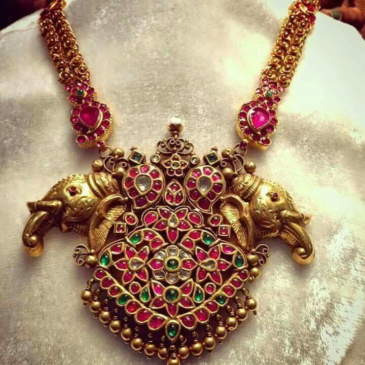 Gorgeous statement elephant designed necklace. Ruby and gold necklace.