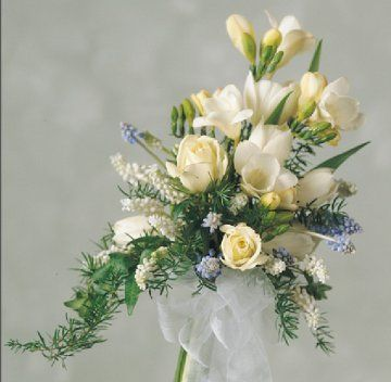 I like the freesia in this boquet, we can add some coral and light pink to it. I like the shape..