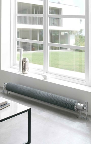 The Halo radiator is floor mounted which means it can sit in front of full length windows or against a low wall as shown. Overall heights start from only 130mm!