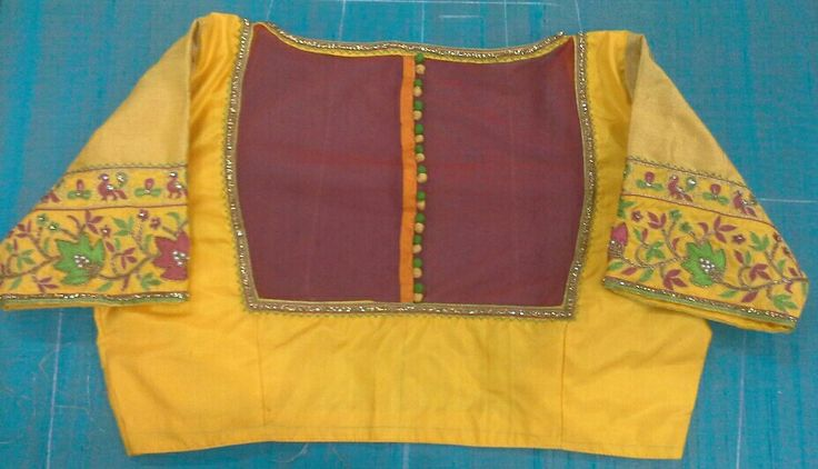 Pattu blouse with maggam work with back high neck with net and buttons 7702919644