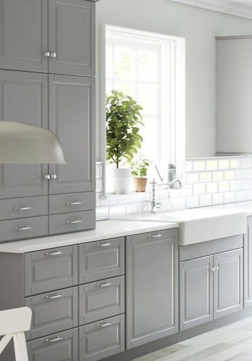 Grey cabinets, white subway tiles, white countertops