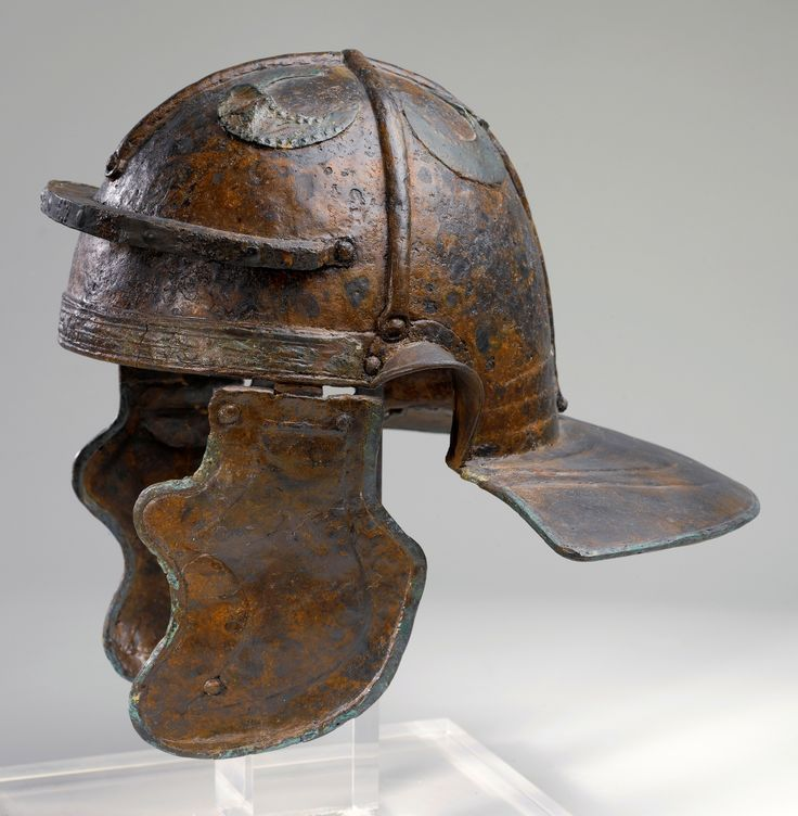 """Image 1: Imperial Italic """"G"""" helmet, discovered in Hebron, Israel and dated to the early II cent. CE, with reinforcement bands and appliques of half moons on crown. Probably a spoil of war taken by Jewish zealots during the Bar Kokhba Revolt (132-135 CE)."""