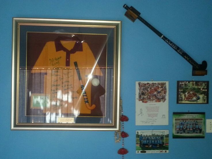 Hand made brackets for mounting my field hockey stick on my hockey wall