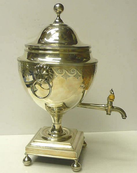 "A handsome antique sterling silver samovar with lions mask handles and ivory tap finial. With finely engraved border decoration to both body and lid. The lid has a stag crest to one side and the Scottish family name ""Fraser"" engraved to the other.  Weight 2971 grams, 95.5 troy ounces. Height 47 cms. London 1792. Maker Thomas Graham"
