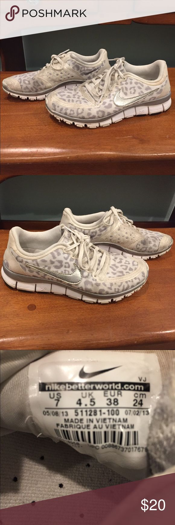 Gray and White Cheetah Print Nike Tennis Shoes They have been worn but are in very good condition! Such cute, exclusive NIKE shoes! Nike Shoes Sneakers