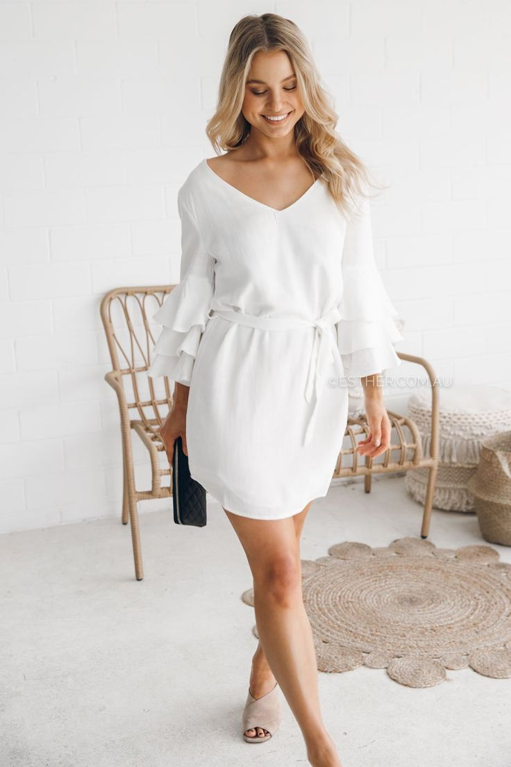 fit:standard sizing, mediumweight fabric, lined, flare sleeves, v shape neckline at front and back, waist tie, pull on stylecolour:whitefabric:cotton/linen blendlength:approx. 42cm from waist to hemlineour model is 163cm tall and is pictured in a size 8/S, 4 US, 8UK
