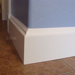 Squared baseboards on a rounded wall.  I like it.  This page includes a tutorial…