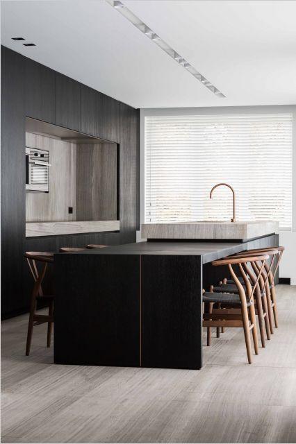 Kitchen designed by Dejaeger Interieur Architecten - worktop in oak grey - woodstructure natural stone by Hullebusch