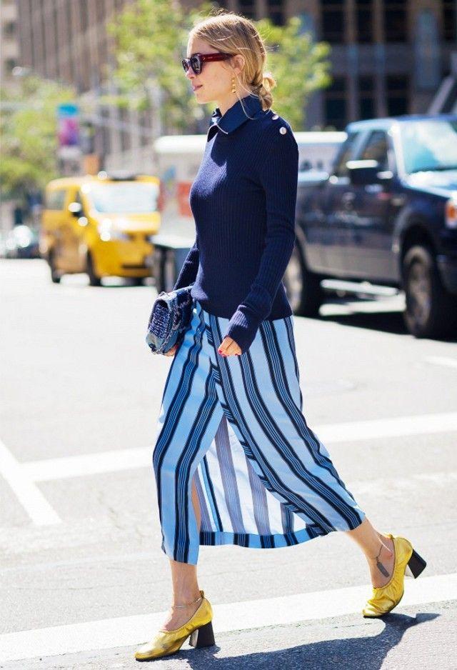 Pernille Teisbaek wears a sweater, striped warp skirt, and Céline gold glove heels